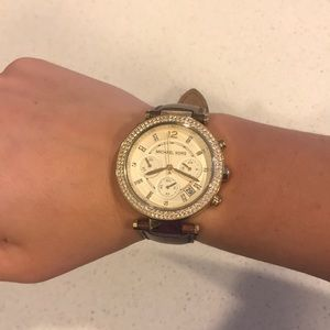 Gold Michael Kors watch with brown leather strap